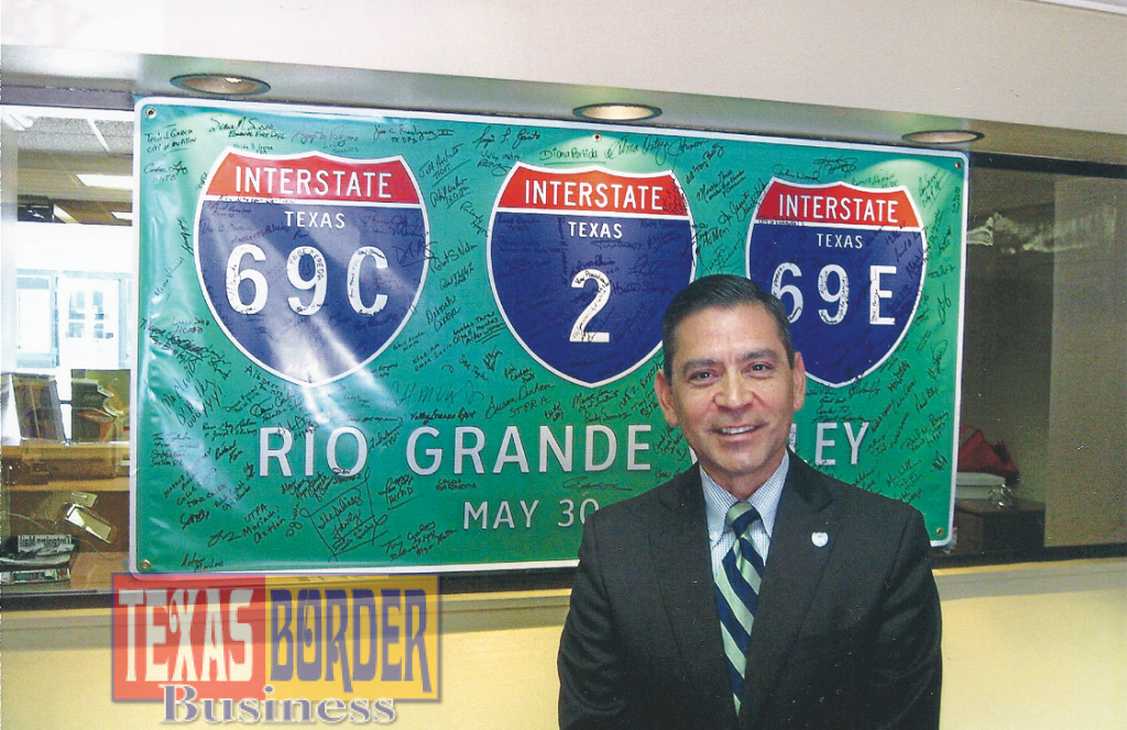 Julian Alvarez, President/CEO of the Rio Grande Valley Partnership. Interstate Highway I-69 signs going up on Valley highways.