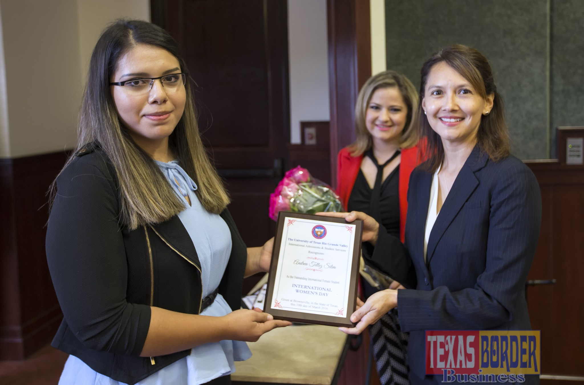 UTRGV celebrated International Women's Day on the Brownsville Campus on Thursday, and named Andrea Silva, left, an Outstanding International Female Student. Presenting her award is Karina Stiles-Cox, chair of the Women's Faculty Network. (UTRGV Photo by David Pike)