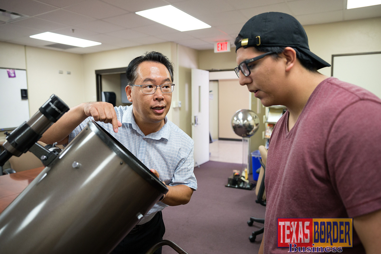 UTRGV astronomy lecturer Dr. Hyun-Chul Lee goes over the components of a telescope with Jose Ortiz, an Edinburg student in the UTRGV High School Research Scholars Program. Their focus has been on measuring the age and chemical composition of stars and galaxies. (UTRGV Photo by Paul Chouy)