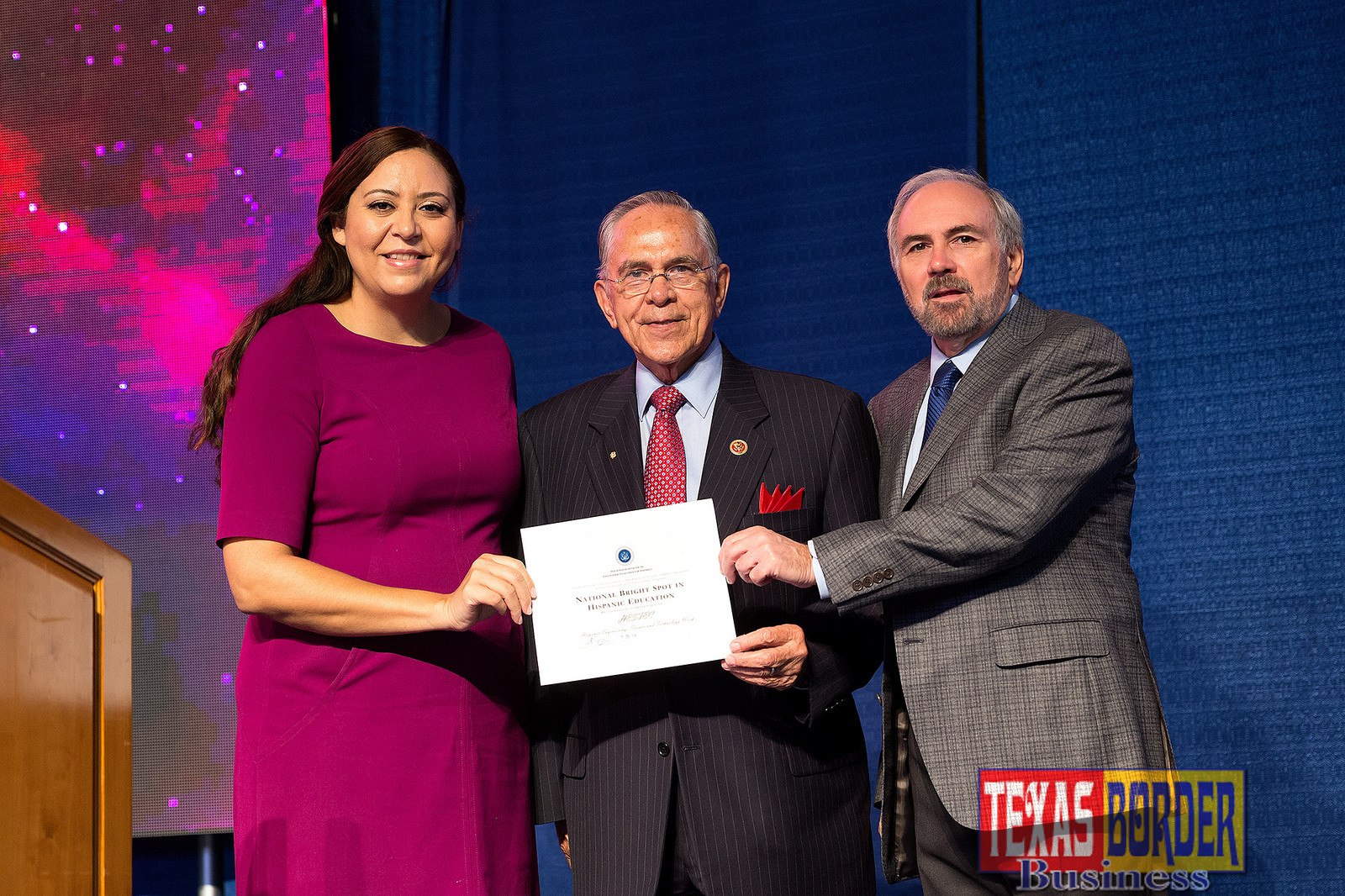 "Alejandra Ceja, executive director of the White House Initiative on Educational Excellence for Hispanics, presented U.S. Rep. Rubén Hinojosa (Texas District 15) and UTRGV President Guy Bailey with an award recognizing HESTEC as a ""National Bright Spot in Hispanic Education,"" during HESTEC Educator Day on Monday, Oct. 3, 2016, at the Fieldhouse on the Edinburg Campus. (UTRGV Photo by Paul Chouy)"