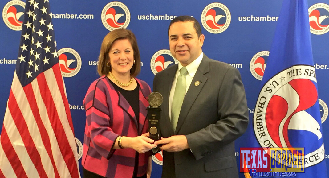 Suzanne Clark, Senior Executive Vice President of the U.S. Chamber of Commerce, presenting the Spirit of Enterprise award to Congressman Cuellar