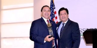 Congressman Henry Cuellar poses with Spirit of Enterprise Award with John Gonzalez, U.S. Chamber of Commerce Director for Congressional and Public Affairs, Southwest/South Central Region.