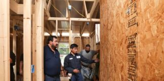 STC HVAC&R instructor Arturo Zamarripa (far left) inspects work being completed by students at a job site in east Edinburg Monday, Sept. 11. Participating in Habitat for Humanity's Builders Blitz event, students with with STC's College Construction Supervision Program, along with its Electrician Program as well as HVAC&R receive hands-on experience while becoming close with the people they serve.