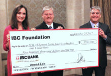 "Dennis E. Nixon, Chair and CEO of IBC Bank (center) presents a ""big check"" to Virginia Garrard, director of LLILAS Benson, and Greg Fenves, president of The University of Texas at Austin. Photo: Carla Silva-Muhammad."