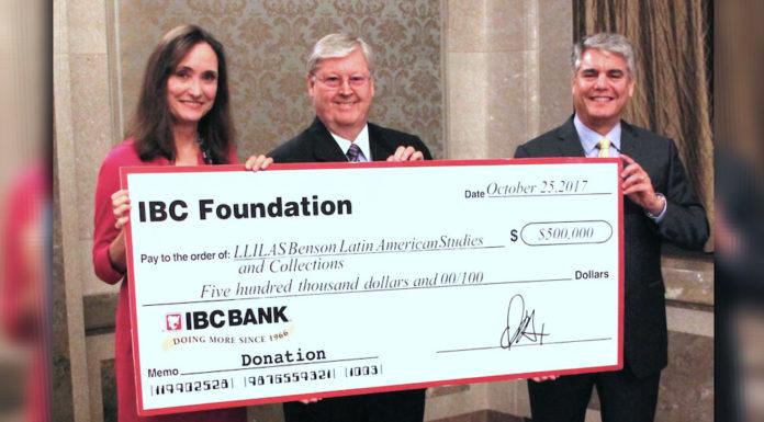 "Dennis E. Nixon, Chair and CEO of IBC Bank (center) presents a ""big check"" to Virginia Garrard, director of LLILAS Benson, and Greg Fenves, president of The University of Texas at Austin. Photo: Carla Silva-Muhammad."