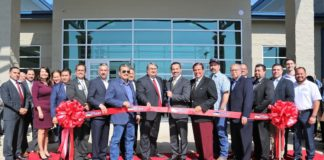 Pharr Mayor Ambrosio Hernandez, M.D., Pharr City Commissioners and EDC Board, EDA Regional Director Jorge Ayala, State Senator Eddie Lucio, State Representative Sergio Munoz, Jr., and other guests at a ribbon cutting ceremony for the new South Pharr Development and Research Center.