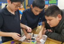 Middle Schoolers uses engineering skills to build a hurricane shelter.