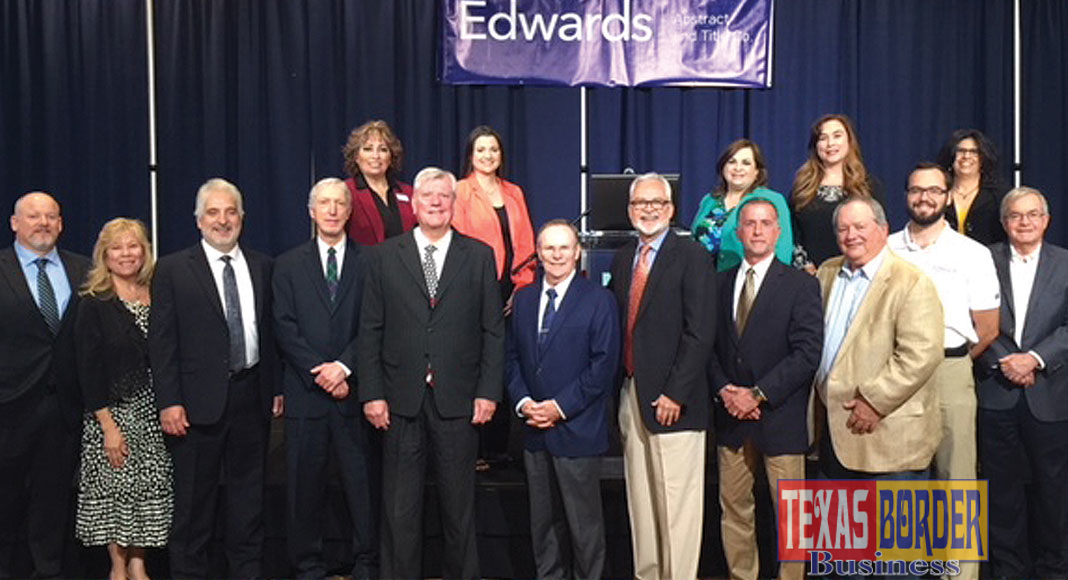 Edwards Abstract and Title Co. welcomed Dr. Ted C. Jones, Ph.D. as the guest speaker during the 14th Annual State of Real Estate Forum held on March 8, 2018. For the past fourteen years the State of Real Estate Forum is coordinated and presented by Edwards Abstract and Title Co. as a resource for real estate industry professionals. Pictured are members of the Edwards Management Team and special invited guests. (First row L-R) Brandon Linscomb, Stewart Title Guaranty Co.; Elva Jackson Garza, Edwards Abstract and Title Co.; Mark S. Pena, Lewis, Monroe & Pena, LLC; Alan Monroe, Lewis, Monroe & Pena, LLC; Dr. Ted C. Jones, Sr. Vice President & Chief Economist with Stewart Title Guaranty Co.; Mayor Jim Darling, city of McAllen; Byron Jay Lewis, Edwards Abstract and Title Co.; N. Michael Overly, Edwards Abstract and Title Co.; D.D. Hoffman, Edwards Abstract and Title Co.; Chris Hughston, Edwards Abstract and Title Co.; and William Rountree, Law Office of William Rountree. Back row: Pamela Dougherty, Edwards Abstract and Title Co.; Mariana R. Ramirez, Edwards Abstract and Title Co.; Marilyn De Luna, Edwards Abstract and Title Co.; Letty Rodriguez, Edwards Abstract and Title Co.; and Diana S. Kaufold, Edwards Abstract and Title Co.