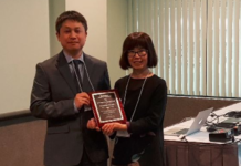 Dr. Myoung-Hwan Kim, UTRGV assistant professor of physics, was named Outstanding Young Researcher for 2018 by The Association of Korean Physicists in America, at the annual meeting of the American Physical Society. Here, he is seen accepting his award from AKPA President Young-Kee Kim at the KPS-AKPA Symposium in March at the Los Angeles Convention Center. (Courtesy Photo)