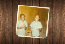 Picture of Two young African American boys receive Christmas gifts from the Boys Clubs of Edinburg, Inc in 1971.