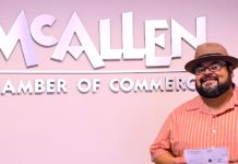 McAllen Poet Laureate Edward Vidaurre Accepts the McAllen Chamber of Commerce's stipend for his services in promoting literary arts in McAllen.