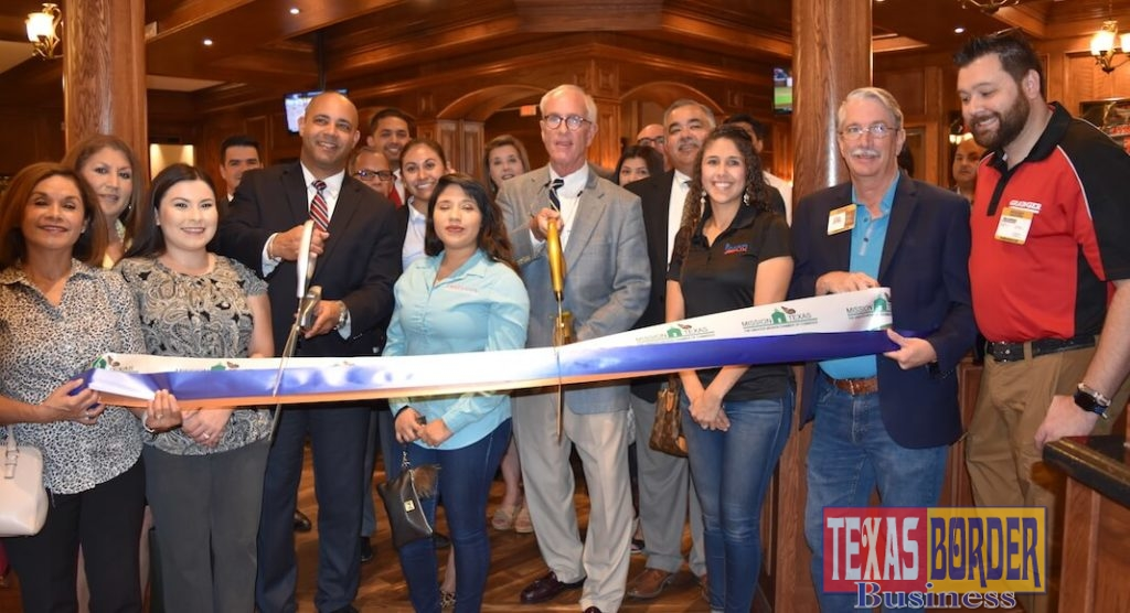 Juan Luis Mussenden, General Manager, and Peter Higgins, Managing Partner of Bob's Steak & Chop House officially announced the beginning of lunch services; they are shown at the ribbon cutting ceremony.