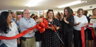 Pictured: Lory Chavez (center), Community Food Project Manager, cuts the ribbon at the Mesa Llena grand opening, with Jack White, Good Neighbor Settlement House Executive Director, and DeAnne Economedes, Food Bank RGV Interim-CEO & COO. The Mesa Llena community food project has opened at the Good Neighbor Settlement House, located at 1216 E. Tyler, Brownsville.The project will serve as a client-choice emergency food pantry, demo kitchen, learning center and incorporate other community partners.Volunteers are needed Tuesday through Friday, 9 am to 5 pm. For more information, contact Carla Lopez, (956) 682-8101 or visit: www.foodbankrgv.com.