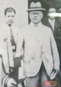 "Left to right: Heriberto Deandar Amador (His portrait is seen in the background) with General Alvaro Obregón of Sonora. General Obregón had lost his arm in 1915 during the Battle of Celaya as he was fighting Francisco ""Pancho"" Villa. They nicknamed him ""El Manco de Celaya."" This photo was taken in Nuevo Laredo, Tamaulipas during Obregón's visit around 1927. He was president from 1920 to 1924."