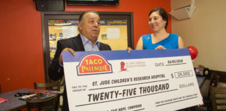 "Pictured above Taco Palenque founder, Juan Francisco ""Pancho"" Ochoa delivering a check for $25,000 to Anyoleth Sanchez, Texas Region St. Jude representative. The effort of raising the funds started in April of this year."