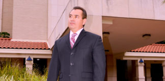 "City Manager Roel ""Roy"" Rodriguez standing outside the McAllen City Hall. Photo archive. By Roberto Hugo Gonzalez"