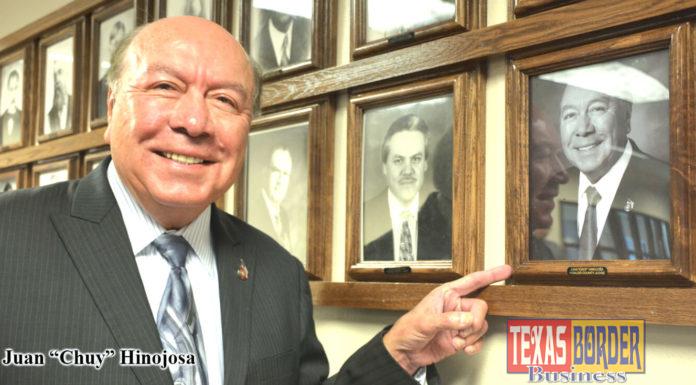 "Sen. Juan ""Chuy"" Hinojosa admires his portrait on the Wall of County Judges."