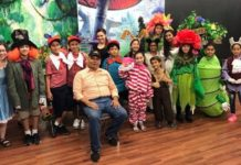 Kids acting teacher and director Juan Guerra sits with his cast from the play Alicia that was produced at Pharr Community Theater.