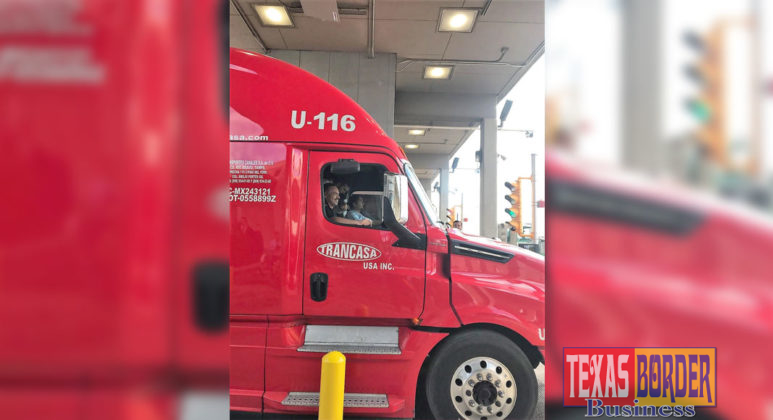 Pharr Mayor Ambrosio Hernandez, M.D., rides in a truck as it cuts through the ceremonial ribbon commemorating the launch of the Pharr International Bridge's new toll system.