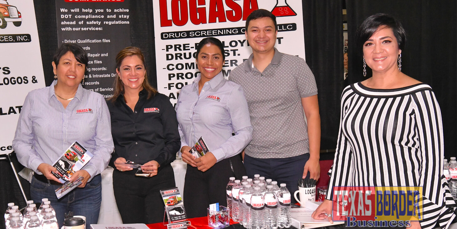Angie Galaviz, Safety Director for Logasa Compliance & Safety Services Inc. (front), behind part of the staff that takes care of companies with multiple trucks and drivers. Photo by Roberto Hugo Gonzalez.