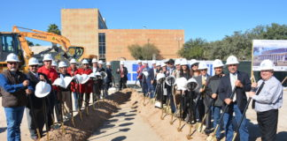 Commissioners Court, elected officials, and Hidalgo County department heads raise a shovel to commemorate the 2018 groundbreaking for the new courthouse.