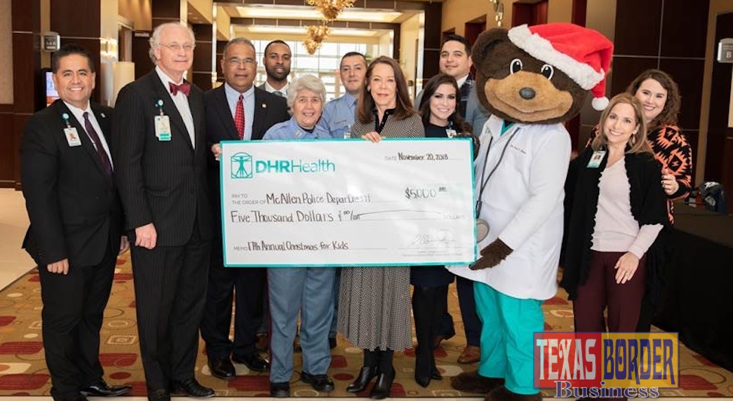 "DHR Health presents a $5,000 donation to McAllen Police Chief Victor Rodriguez and the McAllen Police Department for the 17th Annual McAllen Police Department ""Christmas for Kids"" Toy Drive."