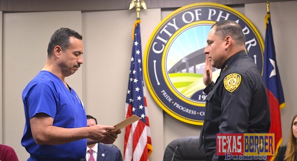 Mayor Ambrosio Hernandez administers the oath of office to Pharr's new Chief of Police, Jose Luengo.