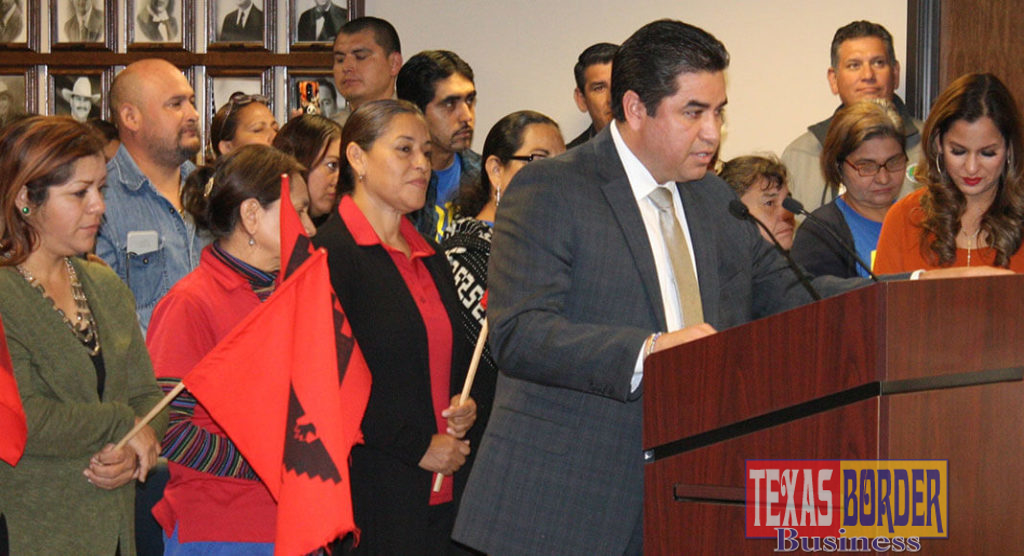 Hidalgo County Criminal District Attorney Ricardo Rodriguez Jr, at the podium surrounded by farm labor activists and staff, announced the grant at the December 4, 2018 Commissioners Court.