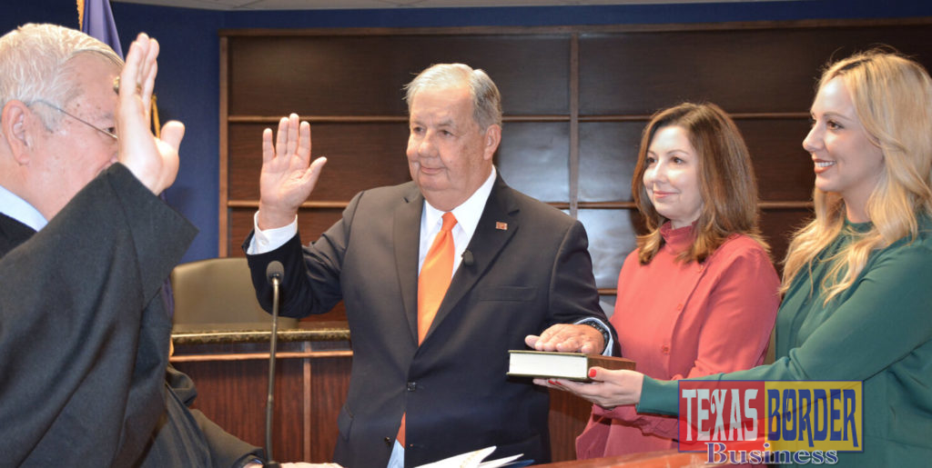 Former McAllen Mayor Richard Cortez as he took the oath of office and his daughters, Sandy Chandrahasan and Laura Mangelschots witnessed the oath administered by District Judge Israel Ramon.
