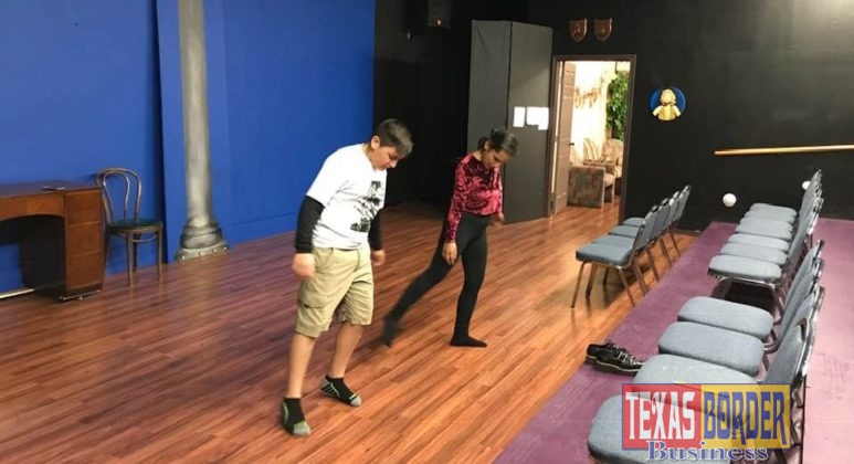 Maria Alvarado teaches young actor Andres Flores dance choreography for his role in a play.