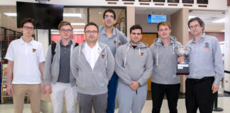 The UTRGV Vaqueros Chess Team returned to the Rio Grande Valley just after 12 a.m. Monday from New York City, riding its second consecutive national win over rival Webster University in the Final Four of Collegiate Chess. The team is seen here just after arrival at the Brownsville South Padre Island International Airport. Coach Bartek Macieja, far right, proudly displays the President's Cup trophy. (UTRGV Photo by David Pike)