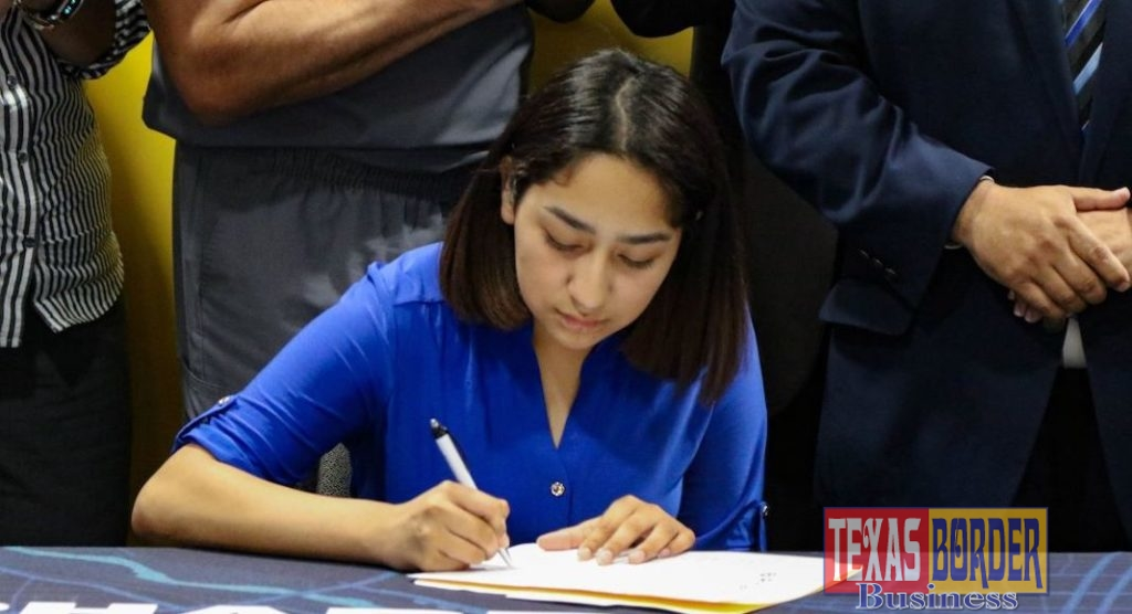 Evelyn Rocha signs her letter of intent to work for the City of Pharr.